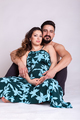 Beautiful pregnant woman with her husband in studio photo