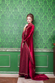 Woman in rich vintage interior and retro rococo clothes