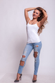 Happy woman in jeans and white shirt