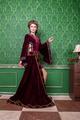 Romantic woman in vintage clothes in retro interior