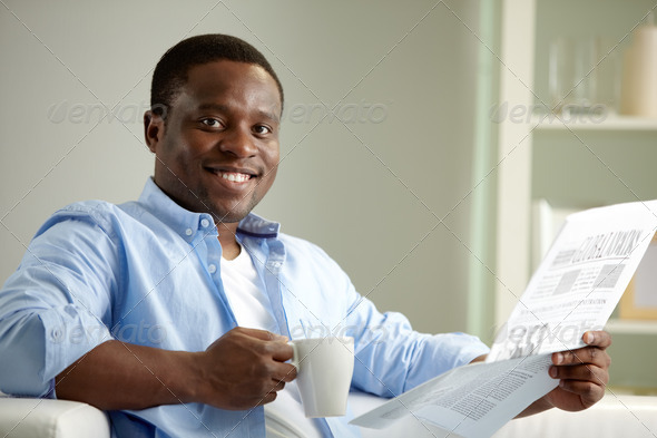 Guy with newspaper - Stock Photo - Images