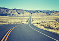 Retro old film stylized asphalt road, travel concept, USA