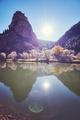 Beautiful mountain sunrise with lens flare effect.