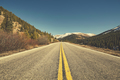 Retro color toned scenic mountain road, Colorado, USA.