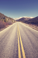 Color toned scenic mountain road, travel concept picture.