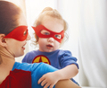 Girl and mom in Superhero costume
