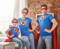 Girl, daddy and mom are Superhero