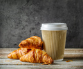 cup of coffee and freshly baked croissants