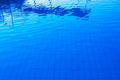 Blue outdoor poolside water surface as abstract background