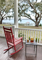 Red rocking chair and iced tea