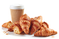 heap of croissants and paper coffee cup