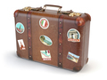 Retro suitcase baggage with travel stickers isolated on white ba