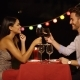 Good Looking Couple Toasts with Glasses of Wine