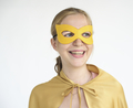 Young blonde smiling superherp costume portrait