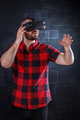 Young man using VR glasses