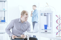Engineer with laptop testing printer