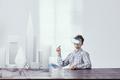 Architect using virtual reality glasses