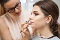 Brunette model at a makeup masterclass