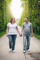 Happy loving couple on a romantic walk outdoors in park