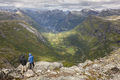 Norwegian rocky mountain landscape with hikers. Norway highlight. Horizontal
