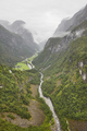 Norwegian foggy landscape with mountain and river. Stalheim viewpoint. Norway