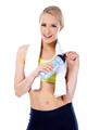 Sporty blond woman posing with water bottle