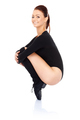 Smiling woman balancing on her toes