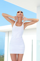 Shapely woman raising her arms in jubilation