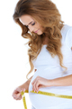 Pregnant woman measurig her belly