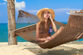Beautiful cute girl relaxing in a hammock