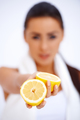 Close up of a woman showing fresh lemon