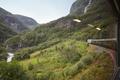 Flam train descent in Norway. Norwegian mountain landscape. Tourism. Horizontal