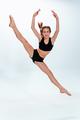 The girl jumping as modern ballet dancer