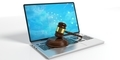 Wooden judge or auction gavel and a laptop on white background. 3d illustration