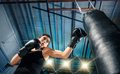 The female boxer training at gym