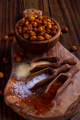 Roasted spicy chickpeas on rustic background