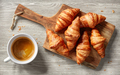 freshly baked croissants and coffee cup