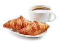 fresh croissants and coffee cup