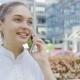 Lovely Girl Talking Phone on Urban Background