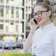 Pretty Girl Talking Phone on Street