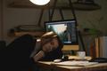 Lady designer sleeping on workspace