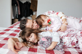 Young pretty woman lying with her children
