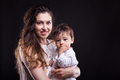 Mother and her little baby boy in studio photo