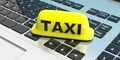 Taxi sign on a computer keyboard. 3d illustration