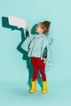 Little girl posing in fashion style wearing autumn clothing.