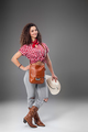 The cowgirl fashion woman over a gray background