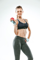 Muscular young woman athlete on white