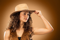 The cowgirl fashion woman over a brown background