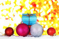 gift on snow with a colorful background.
