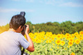 Photographers with a sunflower field.